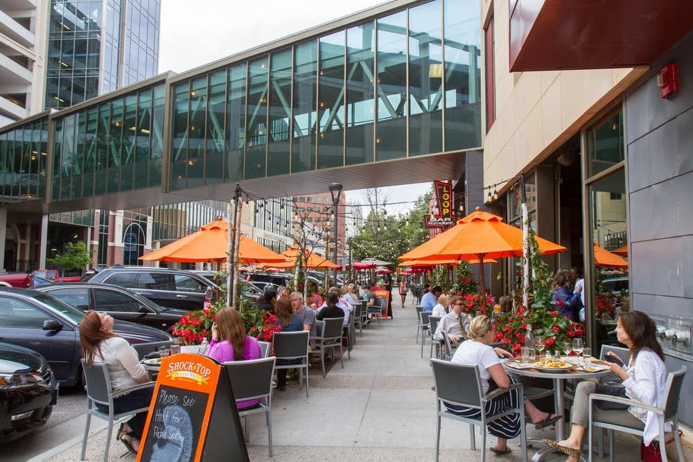 Diners ate at sidewalk tables at The Loop.