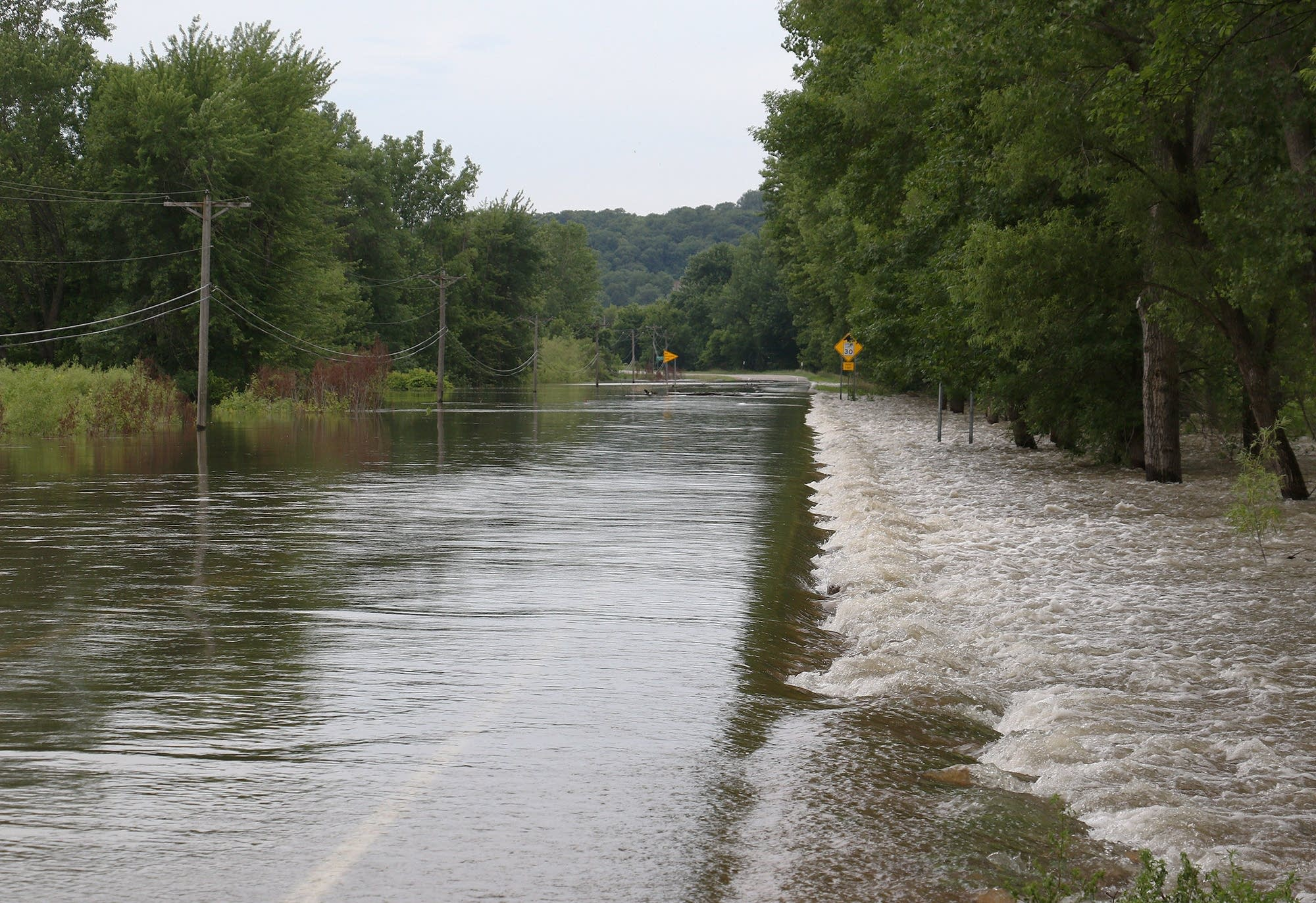 State Highway 19 is covered by the floodwaters of the Minnesota River.