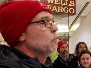 St. Paul Fed. of Teachers president Nick Faber speaks outside Wells Fargo.