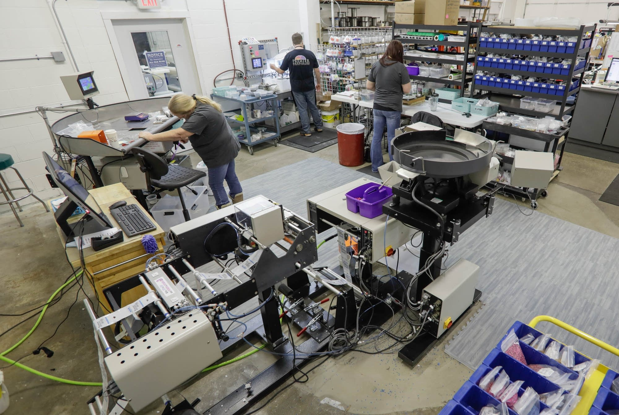 Employees work in the production area nicknamed Oz