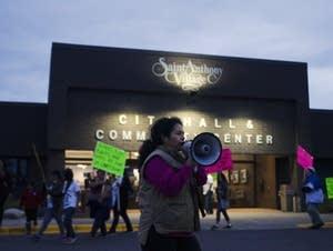 Lowry Grove resident Antonia Alvarez leads chants.