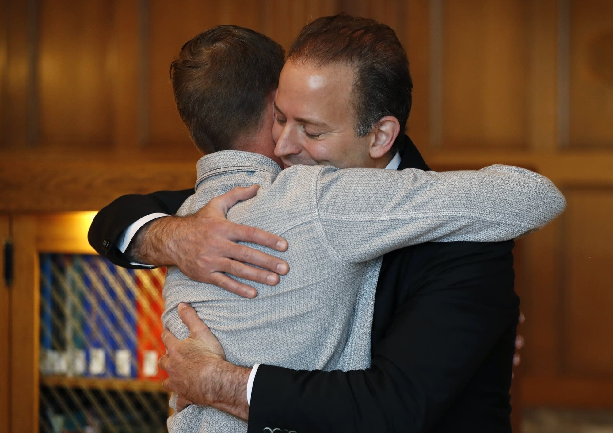 Andy Sandness, left, gets a hug from Dr. Samir Mardini.
