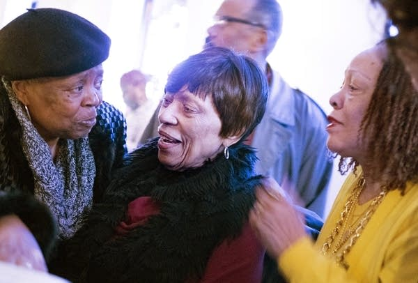 Arnellia Allen, center, talks with Tina Nunn, left, and niece Hazel Bowie.