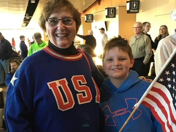 Carol Holm and her grandson Tyler Stage awaited the U.S. Curling Team