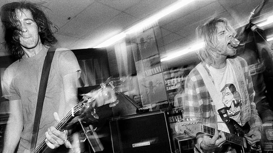 Krist Novoselic and Kurt Cobain play at Beehive Records in Seattle