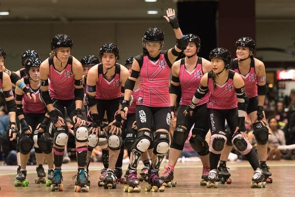 The London Rollergirls greet the crowd.