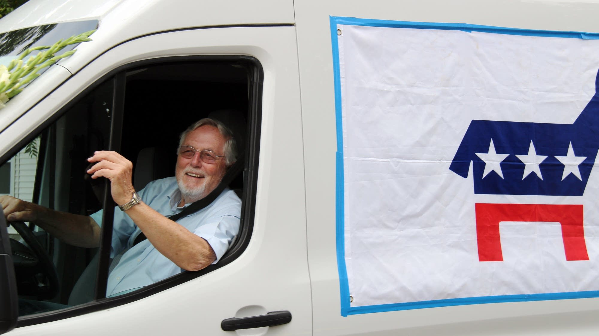 Dick Dahl drives a van promoting DFL candidates.