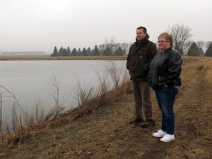 Tracy officials Shane Daniels, Madonna Peterson near a water treatment pond