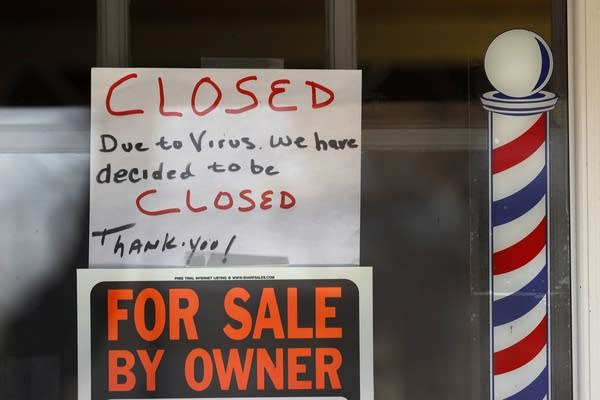 """For Sale By Owner"" and ""Closed Due to Virus"" signs."