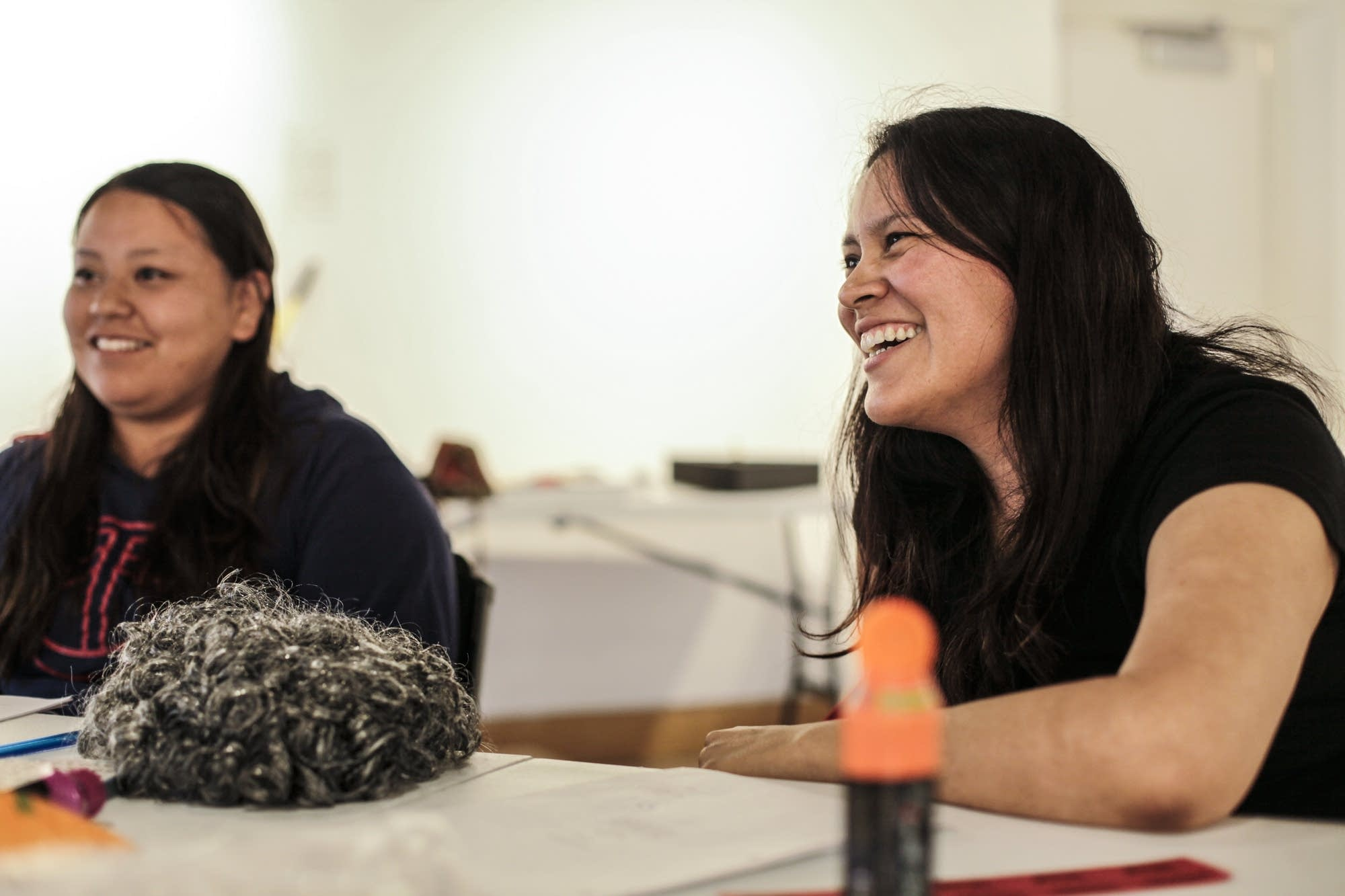 Castmates laugh together as they rehearse their play in Minneapolis.