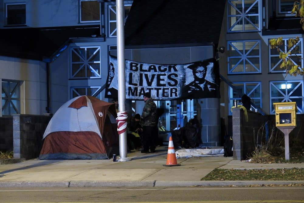 Protesters outside police station