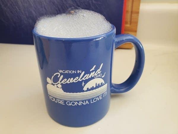 A mug full of soap suds
