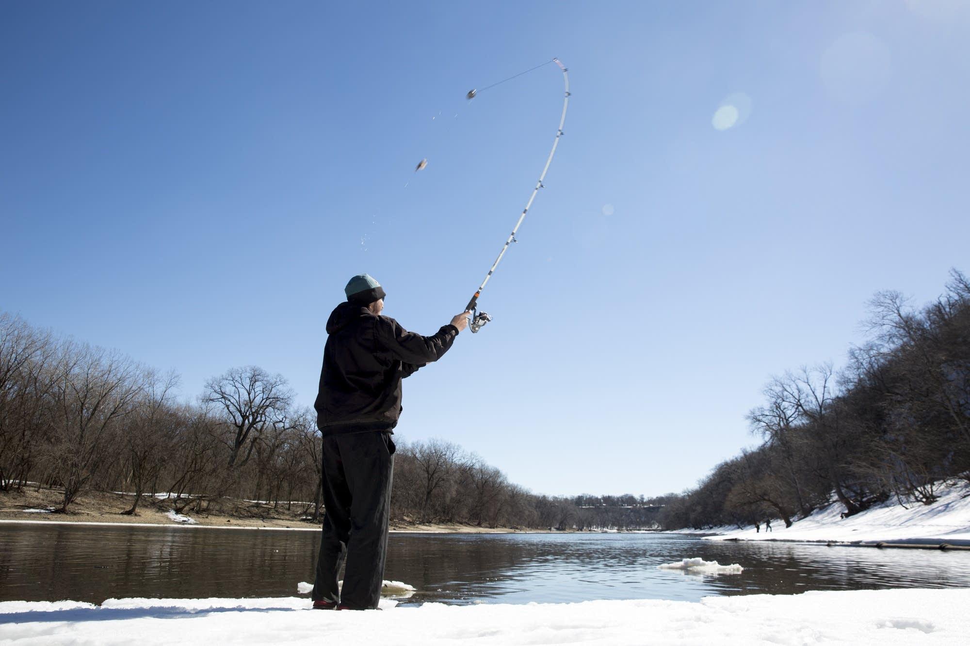 Ryan Dertuleit casts into the Mississippi River near Minnehaha Creek