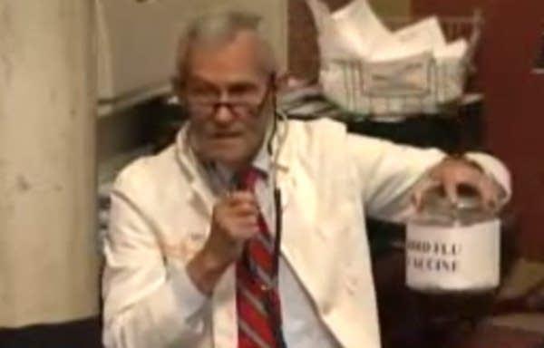 Rep. Ron Erhardt in lab coat