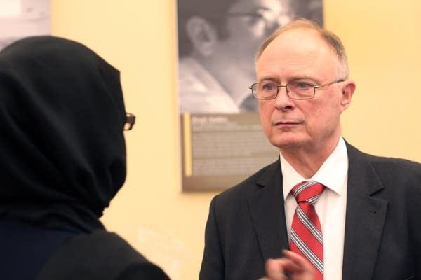 Sen. Jerry Relph listens to Fartun Weli, executive director of Isuroon.