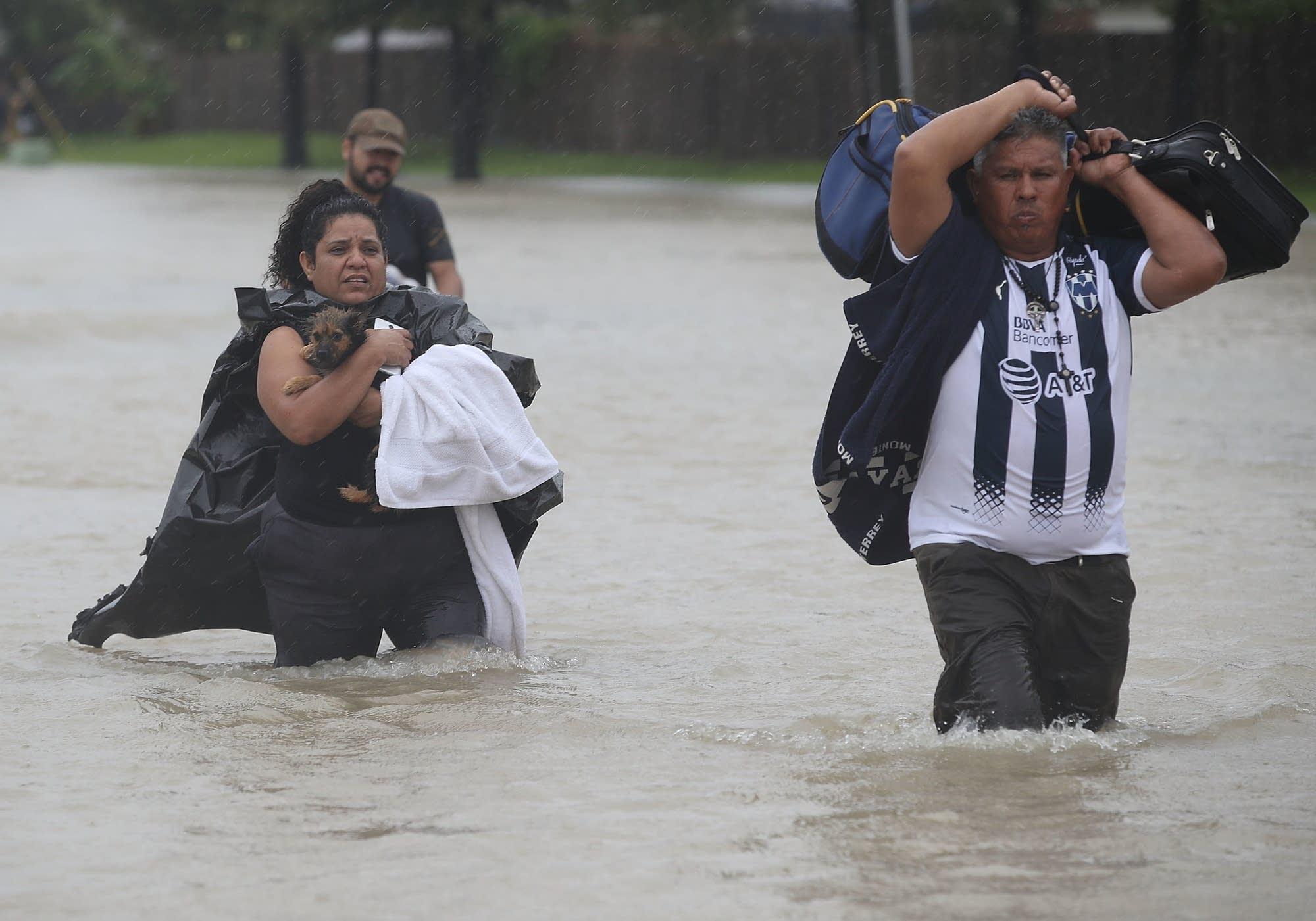 People evacuate their homes.