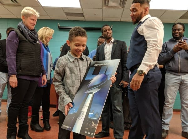 Leo Jackson and his son are given Super Bowl tickets.
