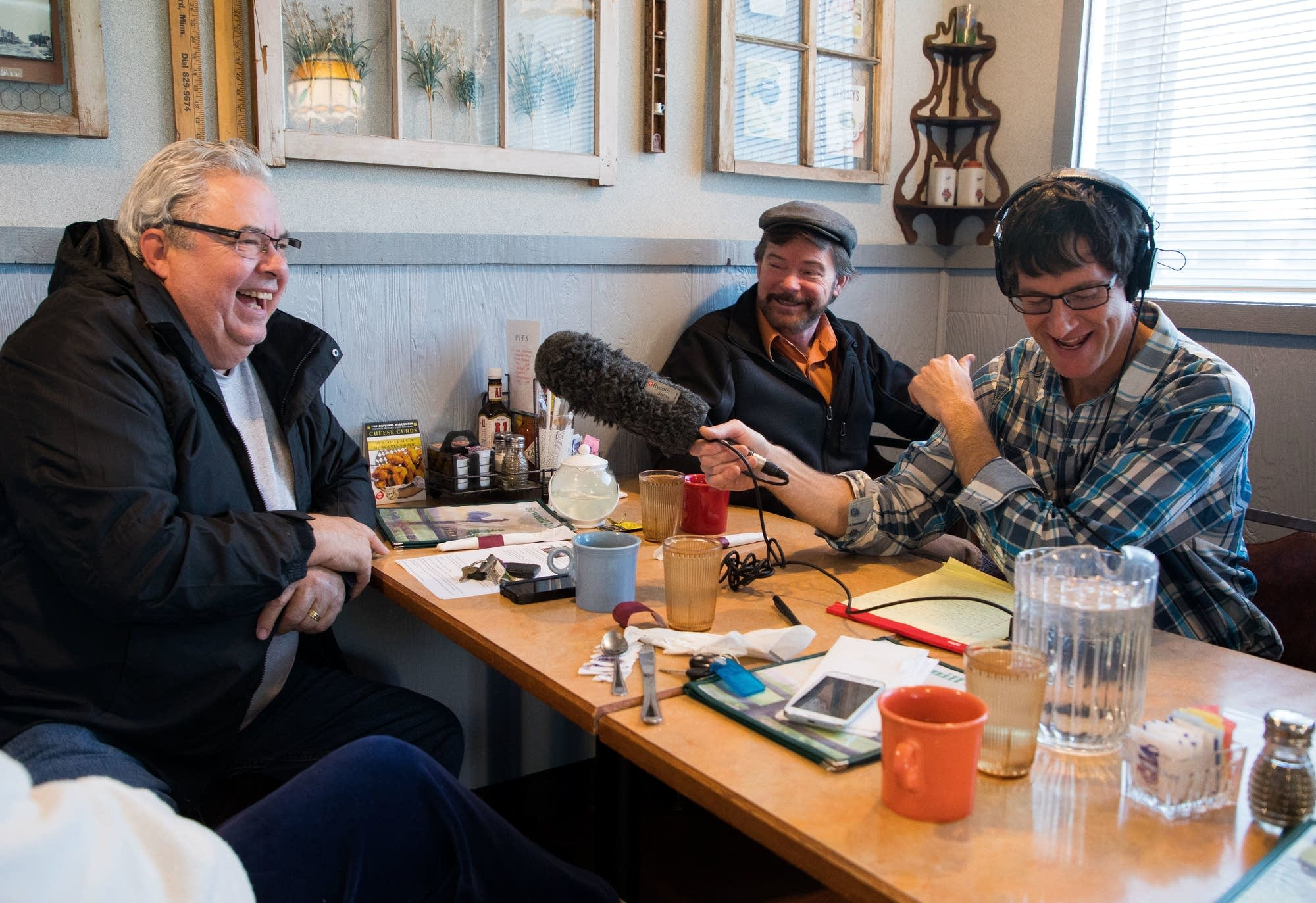 Bill Dian, left, and Doug Kern talk with MPR News reporter Dan Kraker.
