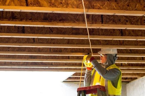 Luke Jeska, 18, a high school student, rigs up a safety light.
