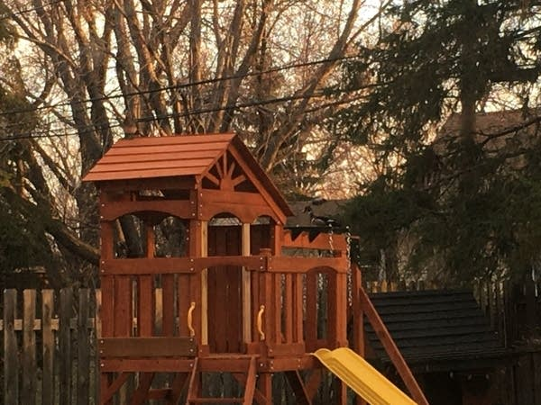 A duck sits on top of a playset