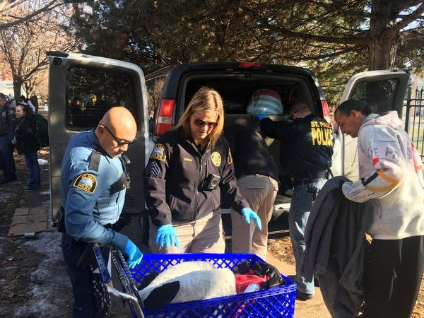 St. Paul Police help to pack up the belongings