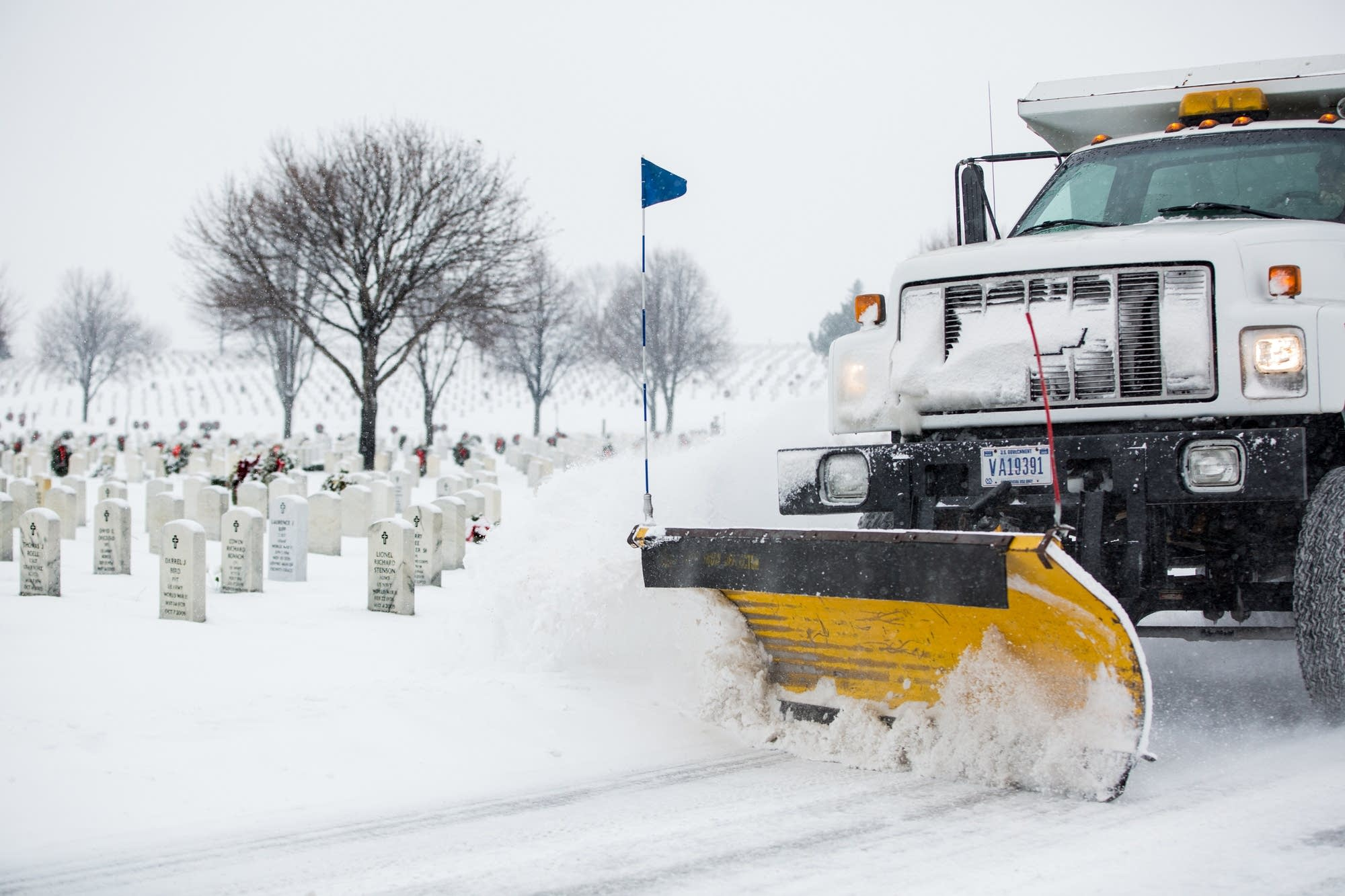 A snowplow inside Fort Snelling National Cemetery