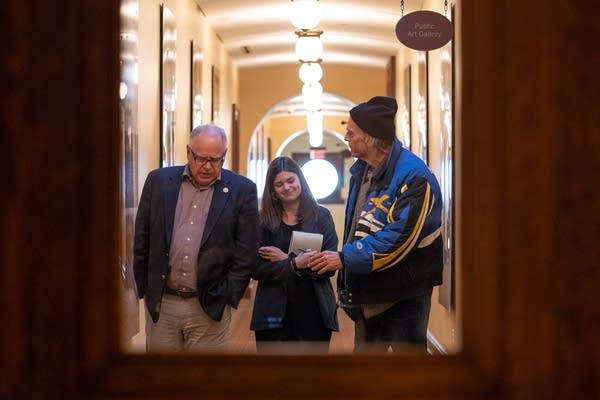 Governor-elect Tim Walz and former Gov. Jesse Ventura leave a meeting.