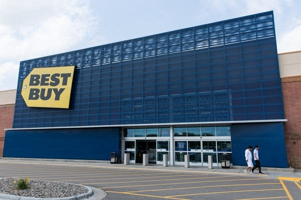 Two shoppers leave Best Buy's flagship store in Richfield, Minn.