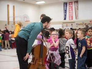 Cellist Lars Krogstad Ortiz chats with children after a concert.