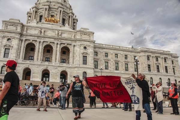 Dancing in front of the Capitol to protest Enbridge's proposed pipeline