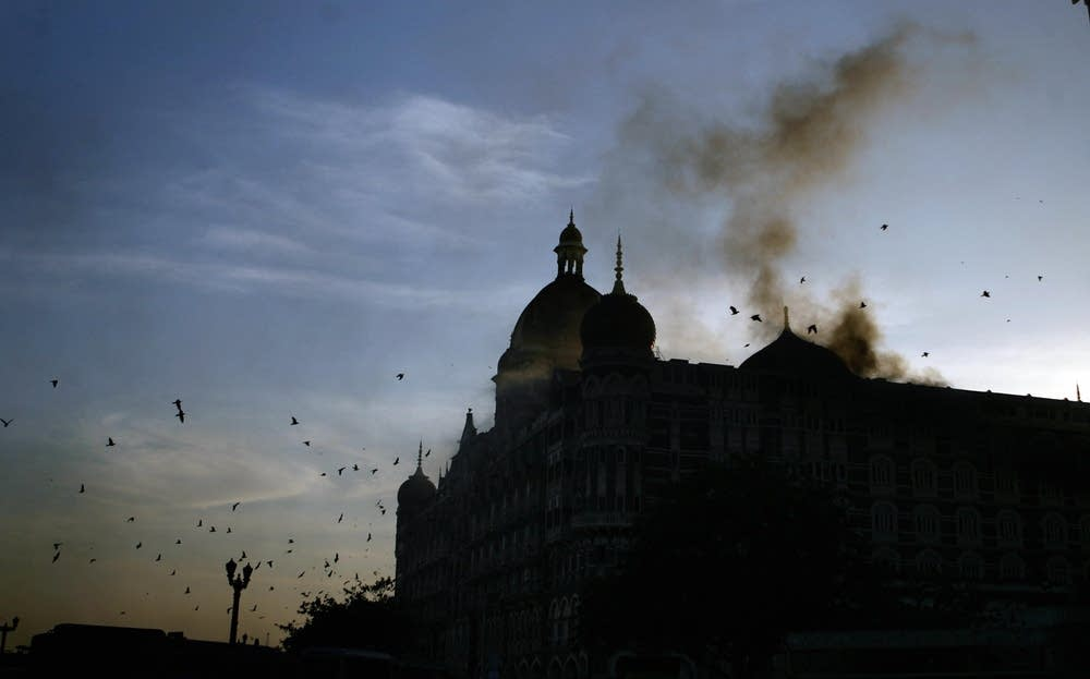 Smoke rises from the Taj hotel in Mumbai