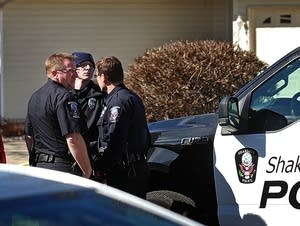 Authorities gather outside the Shakopee home