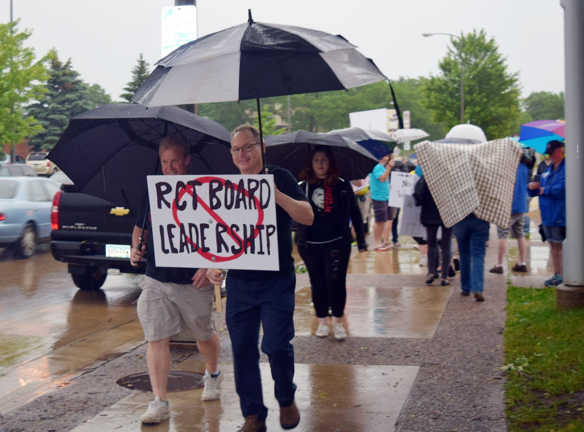 Rochester Civic Theatre volunteers protest the theater's board in June.