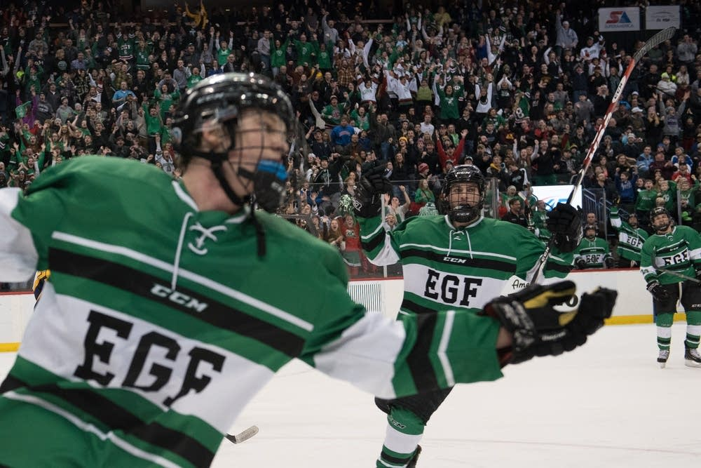 E. Grand Forks celebrated Grant Loven's hat trick.