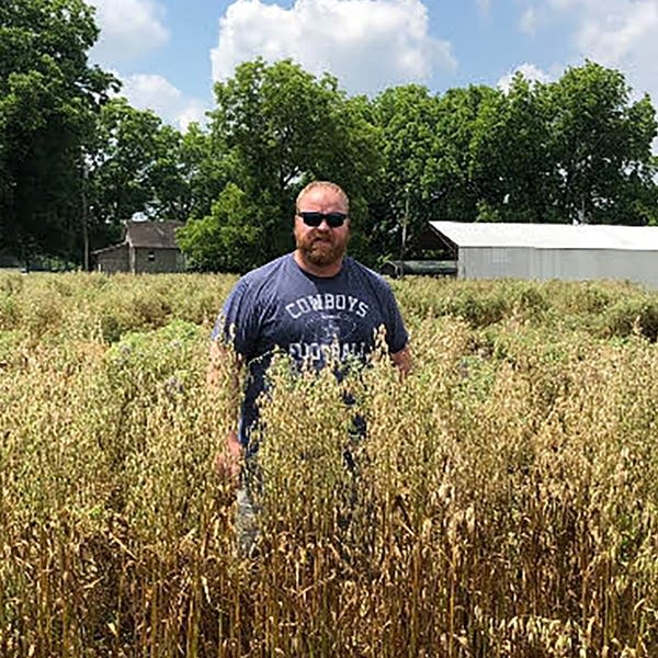 Adam Chappell stands in a field.