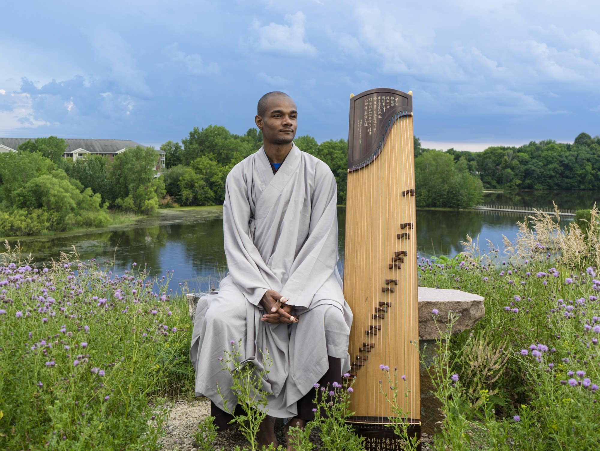 Guzheng player Jarrelle Barton is featured in Wing Young Huie's book.