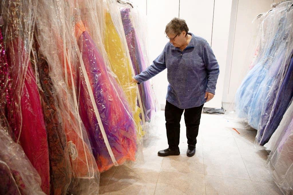 Pam Philipp looks through prom dresses.