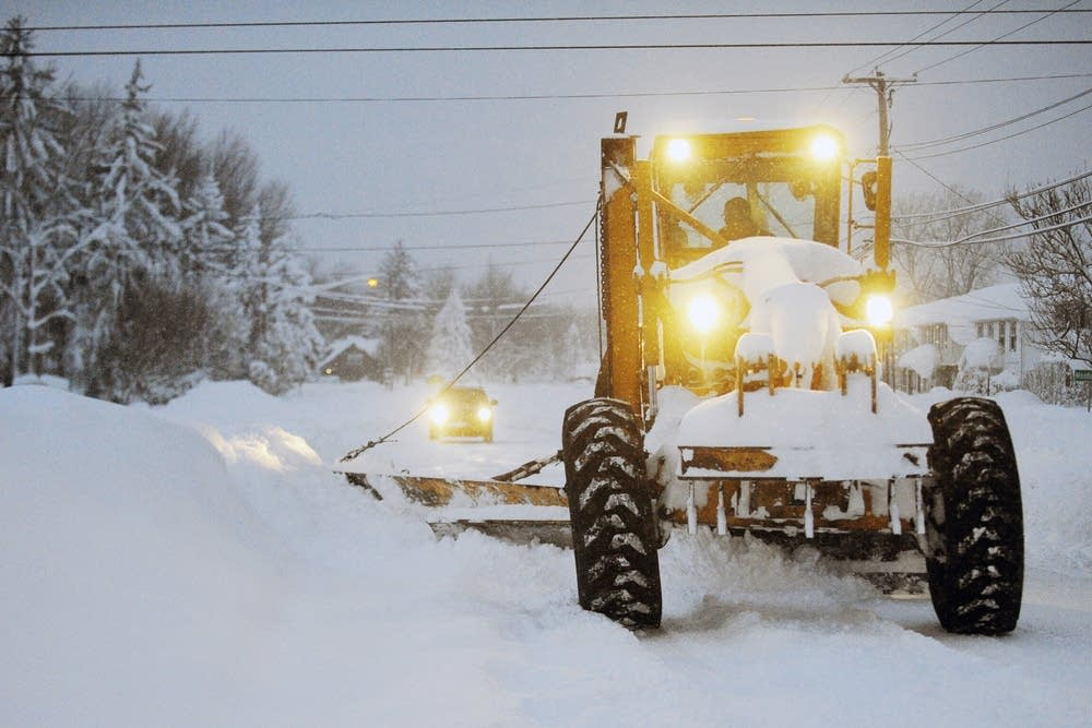 A New York state snowgrader moves snow.