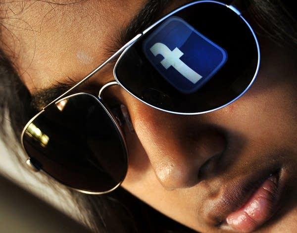 Facebook logo reflected