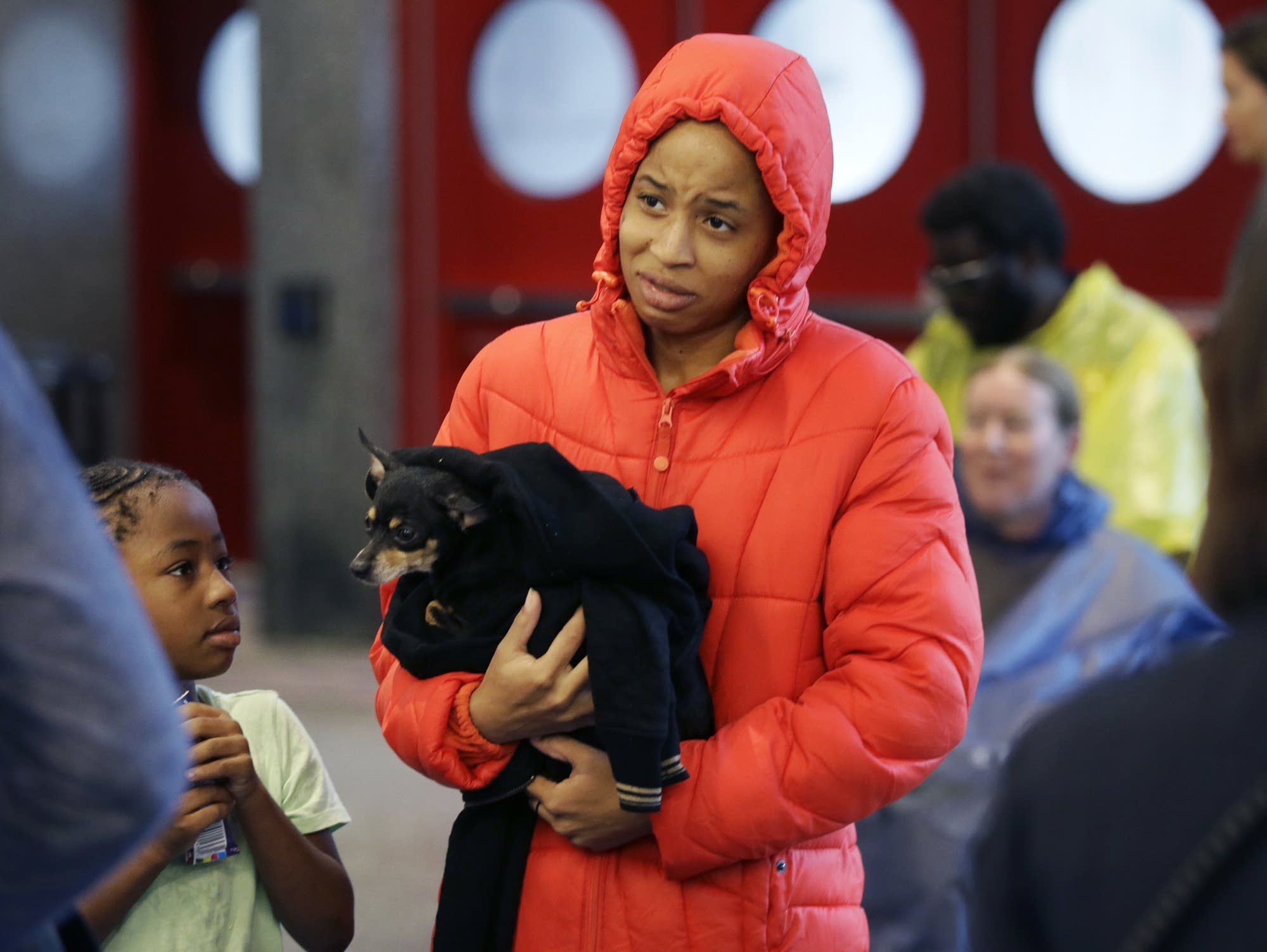 D'Ona Spears is told that she cannot bring her dog into the shelter