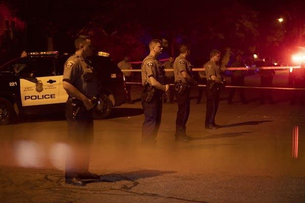 Police guard the scene.