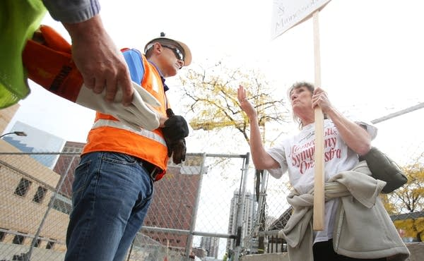 Talking to construction workers