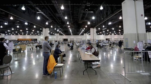 Election workers check ballots