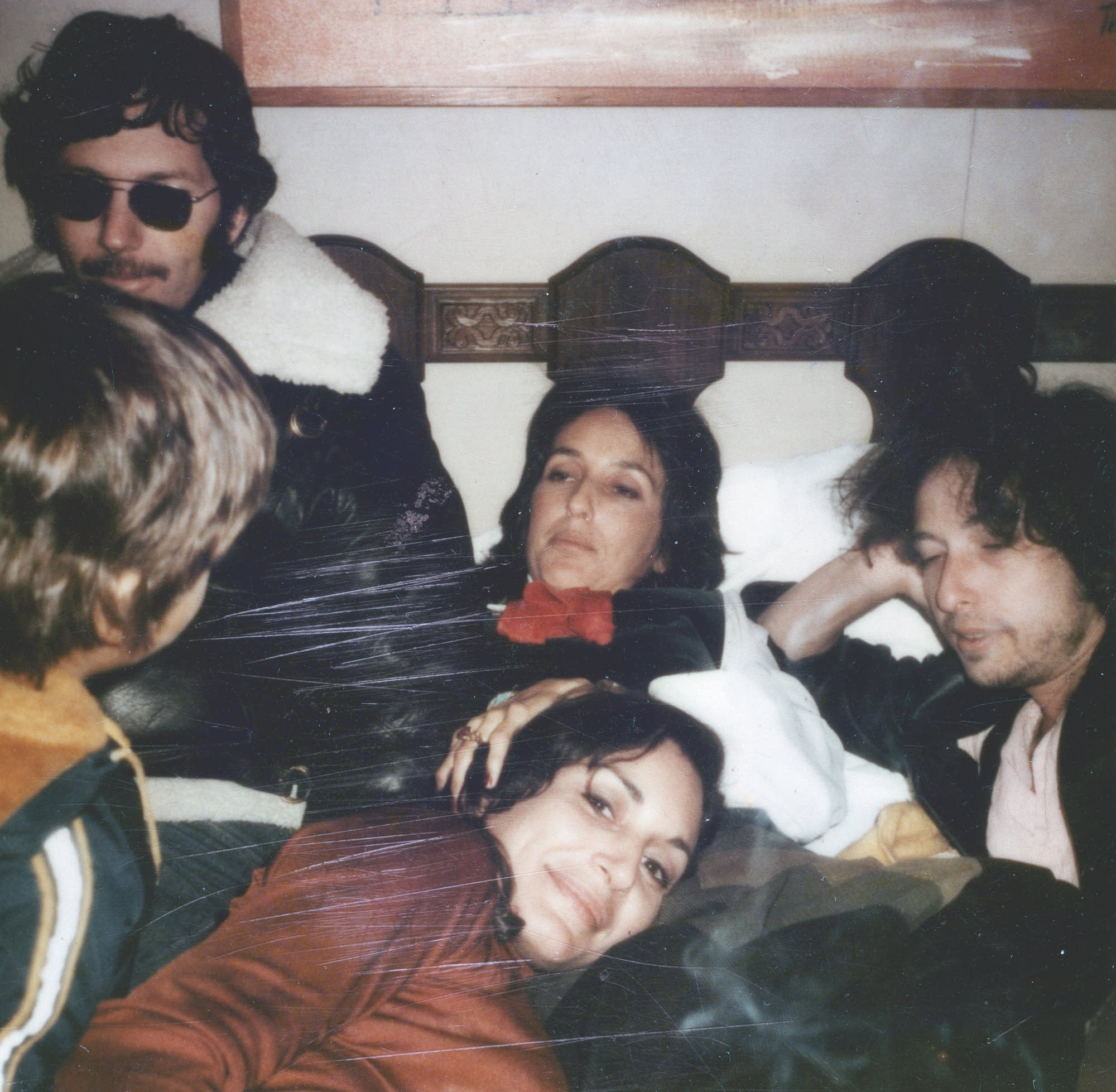 Louie Kemp, Joan Baez, and Bob Dylan relax.