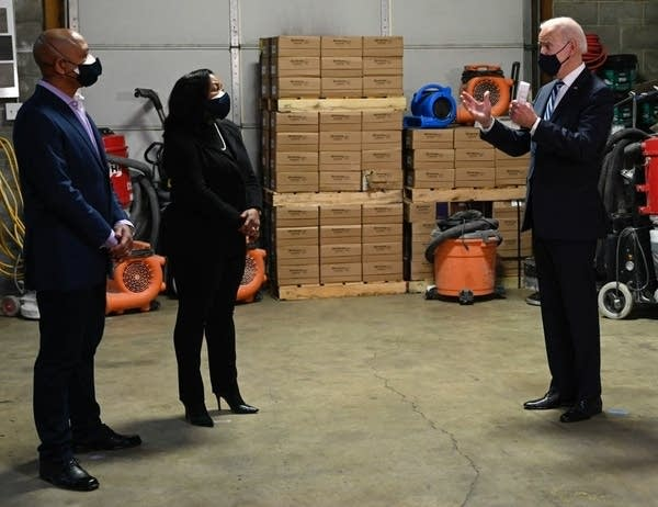 President Joe Biden talks to owners of a small business.