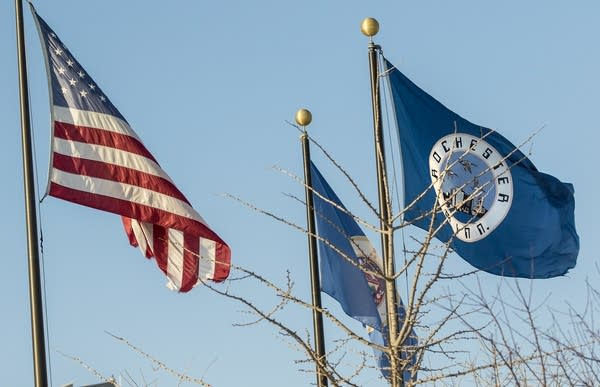The U.S., Minnesota and Rochester flags wave in Rochester.
