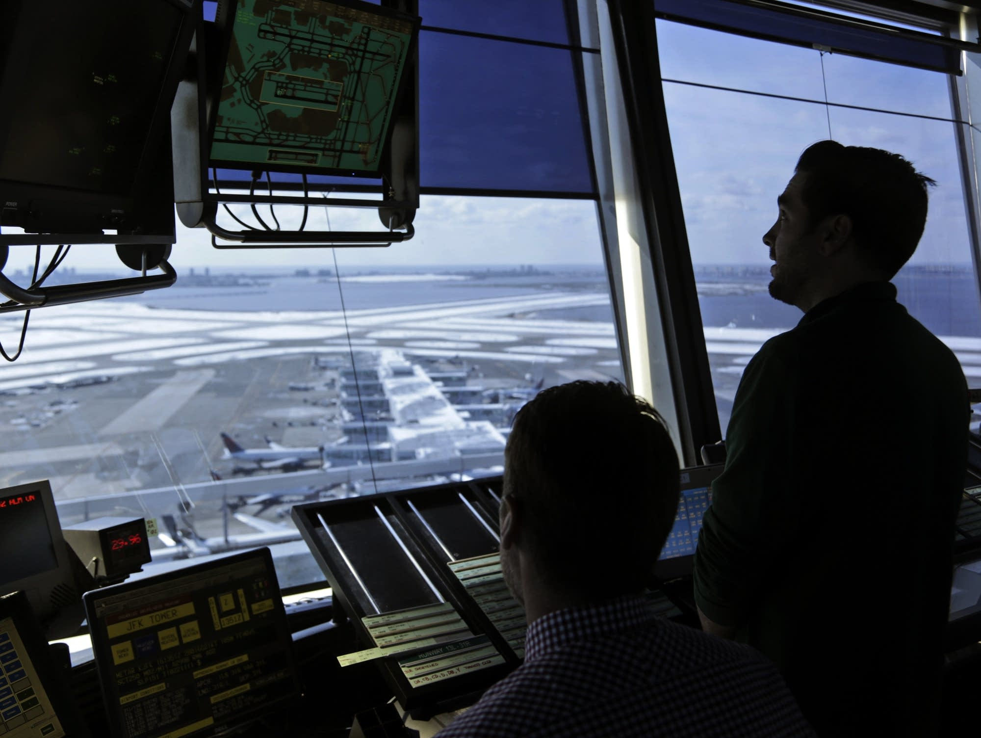 Air traffic controllers work in the tower at JFK Airport in New York.