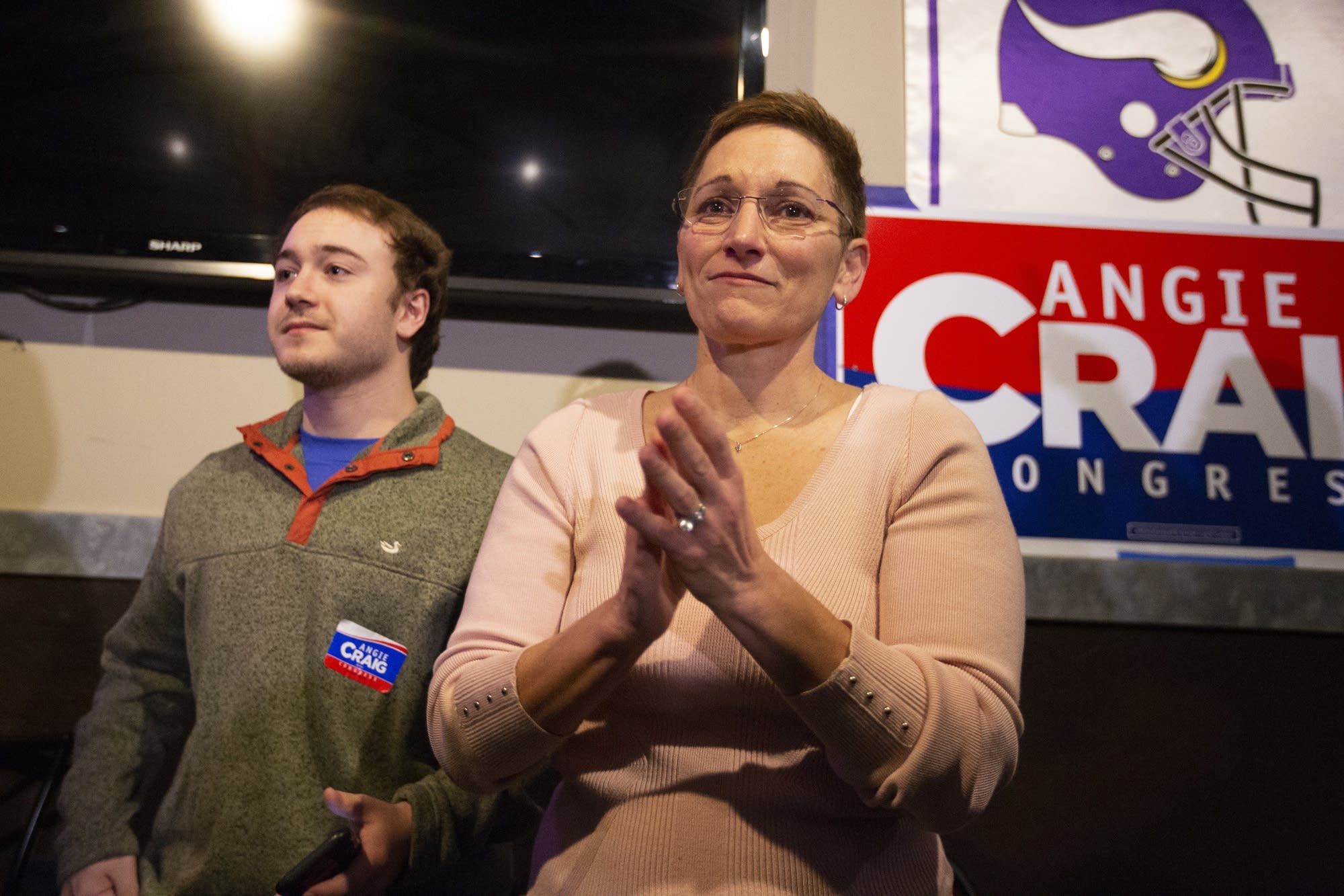 DFL Representative-elect Angie Craig's wife tears up.