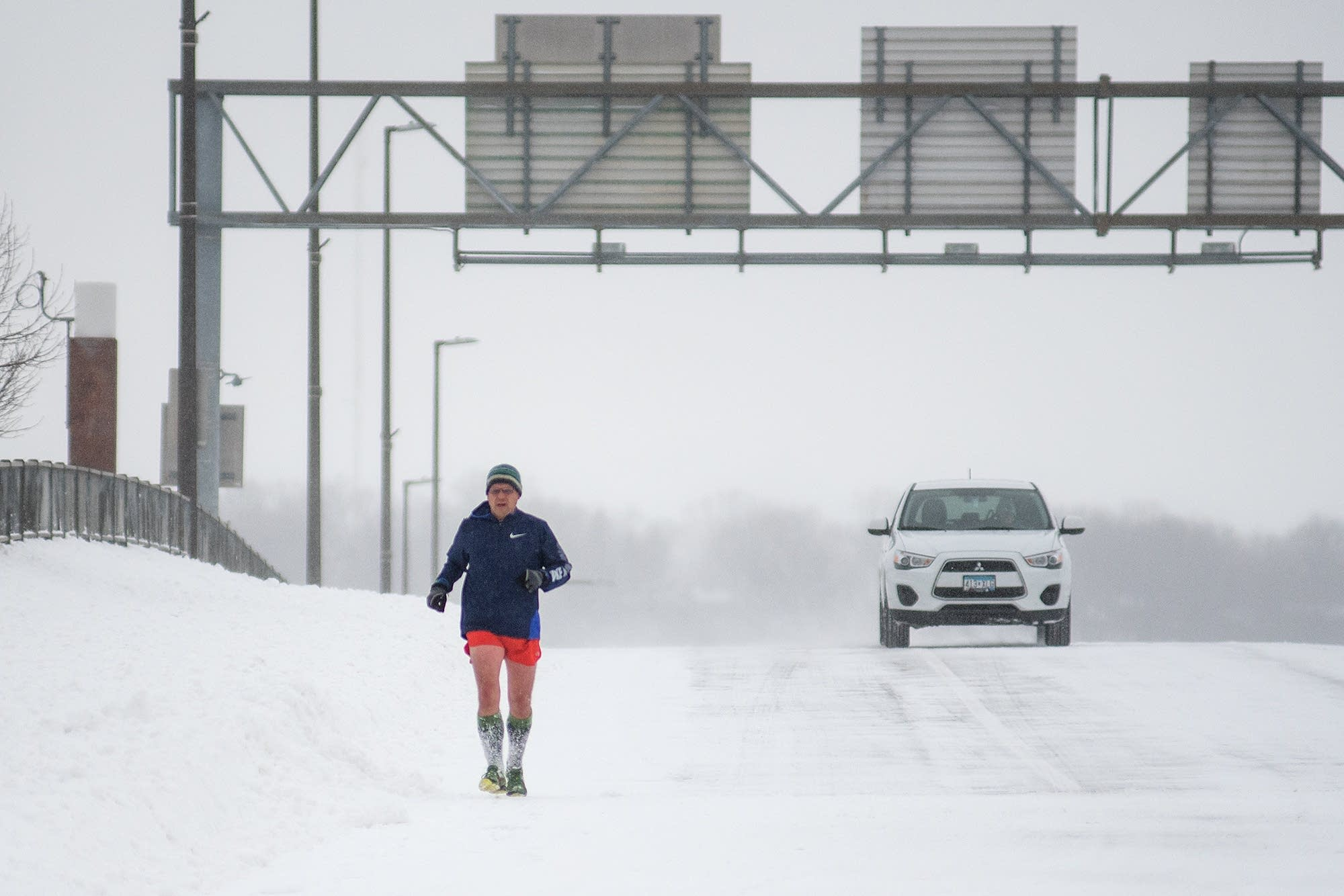 Jeff Schultz runs across Veterans Memorial Bridge in Mankato.