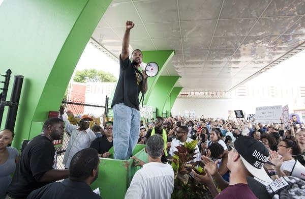 Rashad Turner lead protesters at the fair gates.